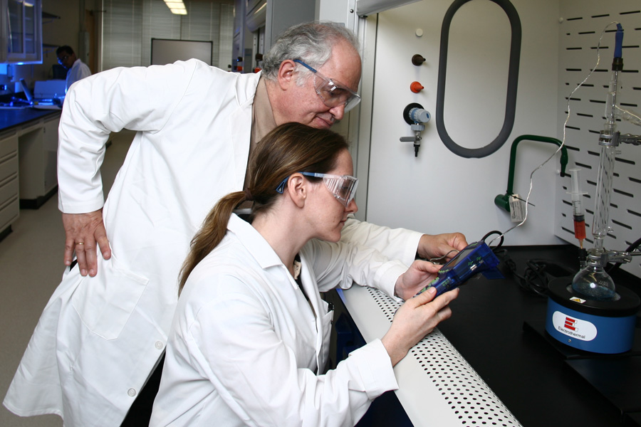 Student in the Chemistry lab with professor