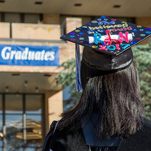 Photo of graduating QCC student with customized cap for commencement 2017